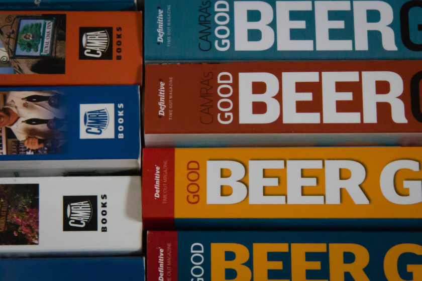 The spines of some editions of CAMRA's Good Beer Guide
